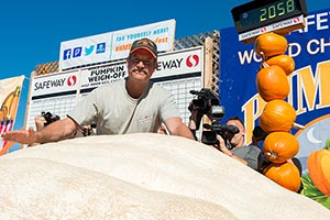 2014 Pumpkin Weigh-Off Winner John Hawkley with his record-breaking 2,058 lb Atlantic Giant