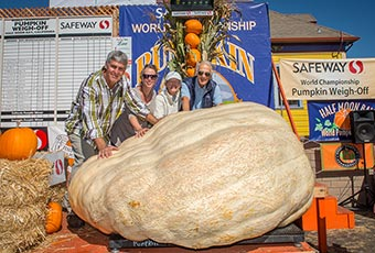 2015 Pumpkin Weigh Off Winner Steve Daletas and family with winning 1,969-pound gourd