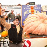2011 winner Leonardo Urena of Napa, CA with his winning 1,704 lb pumpkin