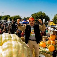 2019 Pumpkin Weigh-Off winner Leonardo Urena celebrates